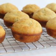 side view of muffins on a wire cooling rack on a white surface