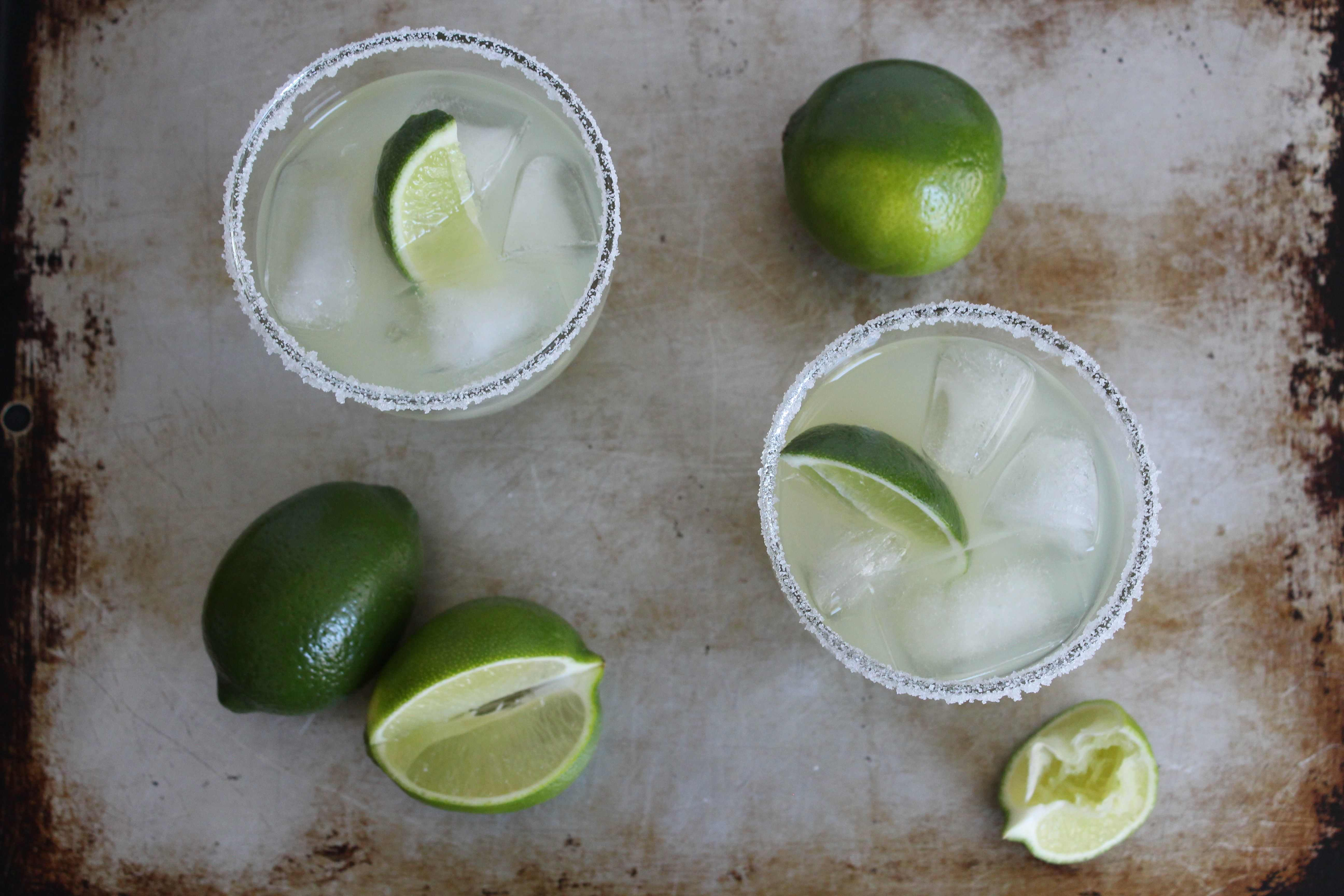 overhead view of margaritas on a metal surface