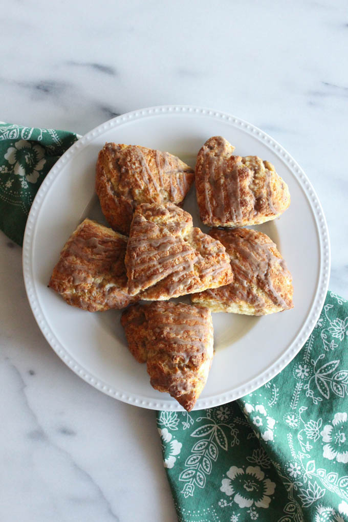 These soft and flaky cardamom scones drizzled with chai glaze are the perfect breakfast treat for Christmas morning - or any day of the year!
