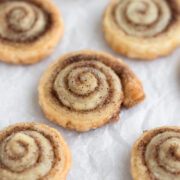 angled view of chai spice pie crust cookies on parchment paper