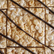 overhead view of Rice Krispies treats drizzled with chocolate