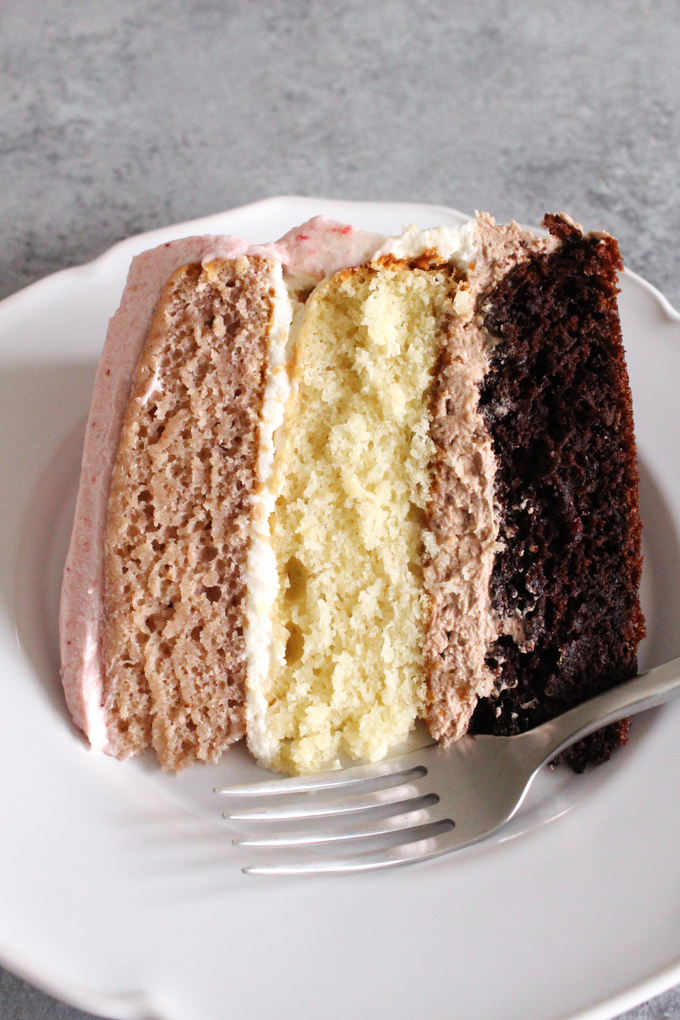 Chocolate, vanilla, AND strawberry - it's the best of all worlds! This Neapolitan cake - made from scratch and without any food coloring - is a totally decadent and delicious treat!