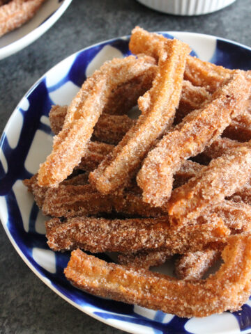 Pumpkin spice adds festive fall flavor to these classic churros. Dipped in chocolate sauce, these pumpkin spice churros are dangerously addicting!