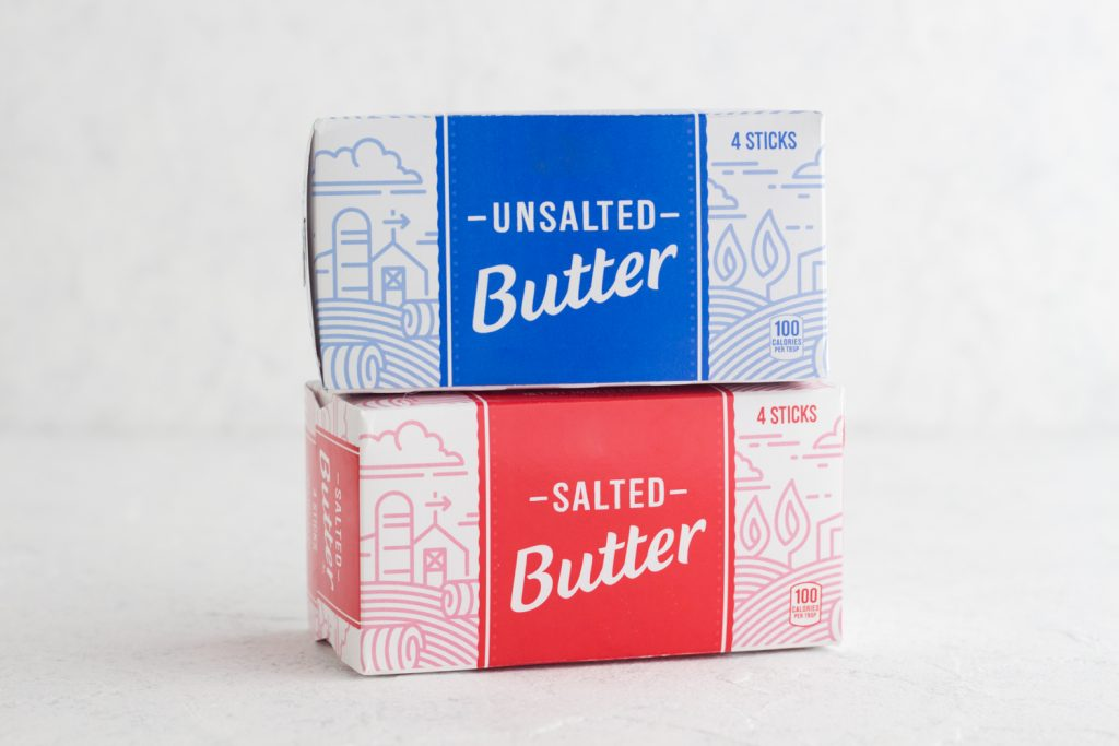butter boxes stacked on a white surface