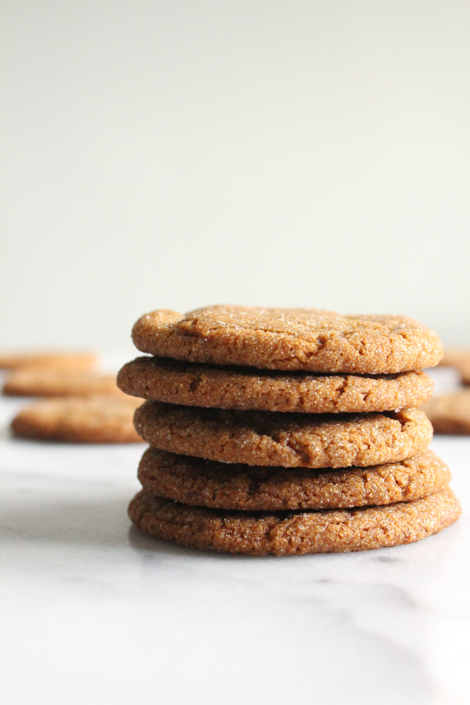 molasses cookies stacked on a marble surface