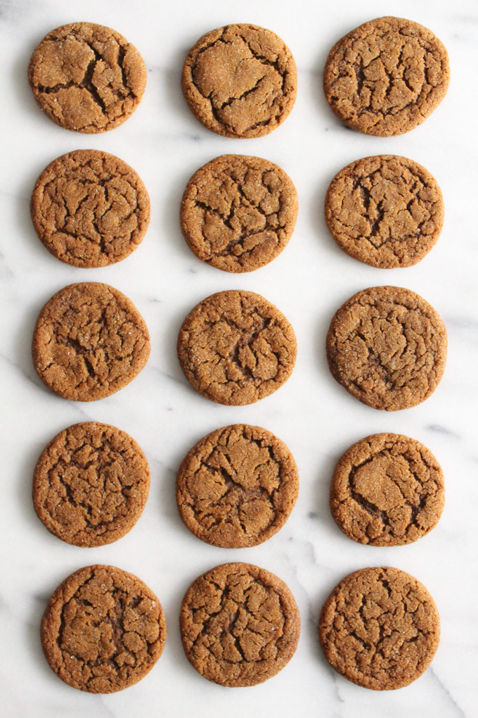overhead view of molasses cookies cookies arranged in rows on a marble surface