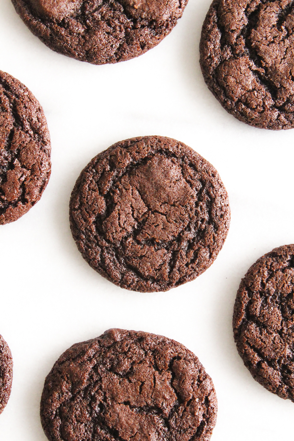 overhead view of dark chocolate cookies on a marble surface