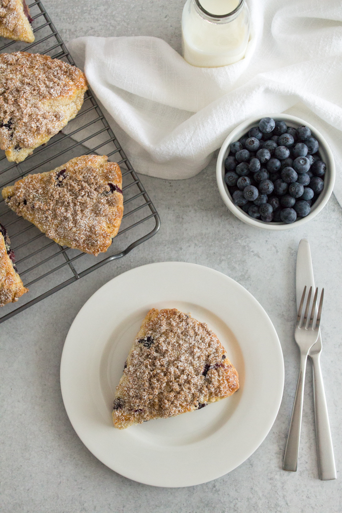 Blueberry Muffin Scones take on all the best qualities of blueberry muffins - a tender crumb, tons of fresh blueberries, hints of tangy buttermilk and lemon, and a cinnamon streusel topping - in scone form!