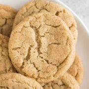 close-up overhead view of chai snickerdoodles stacked on a white plate