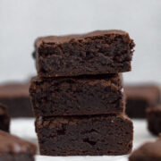 side view of stacked fudgy chocolate brownies