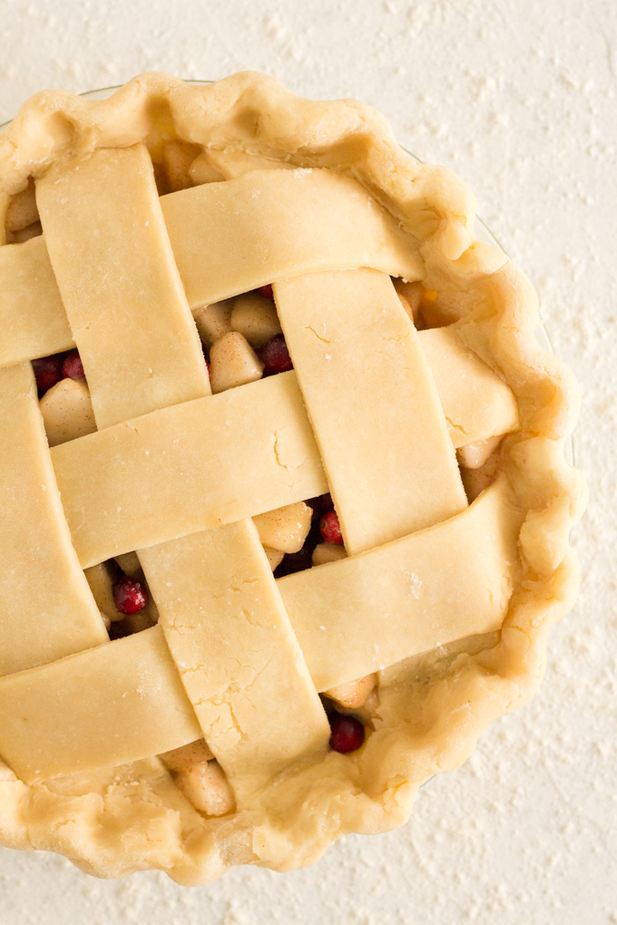 unbaked lattice pie on a white floured surface