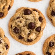 overhead view of chocolate chip cookies on a white surface