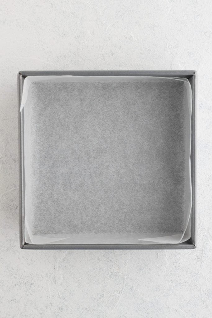 8 x 8 square baking pan lined with parchment paper
