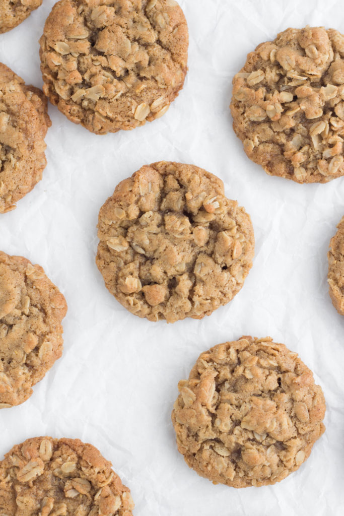 overhead view of brown butter oatmeal cookies on a white surface