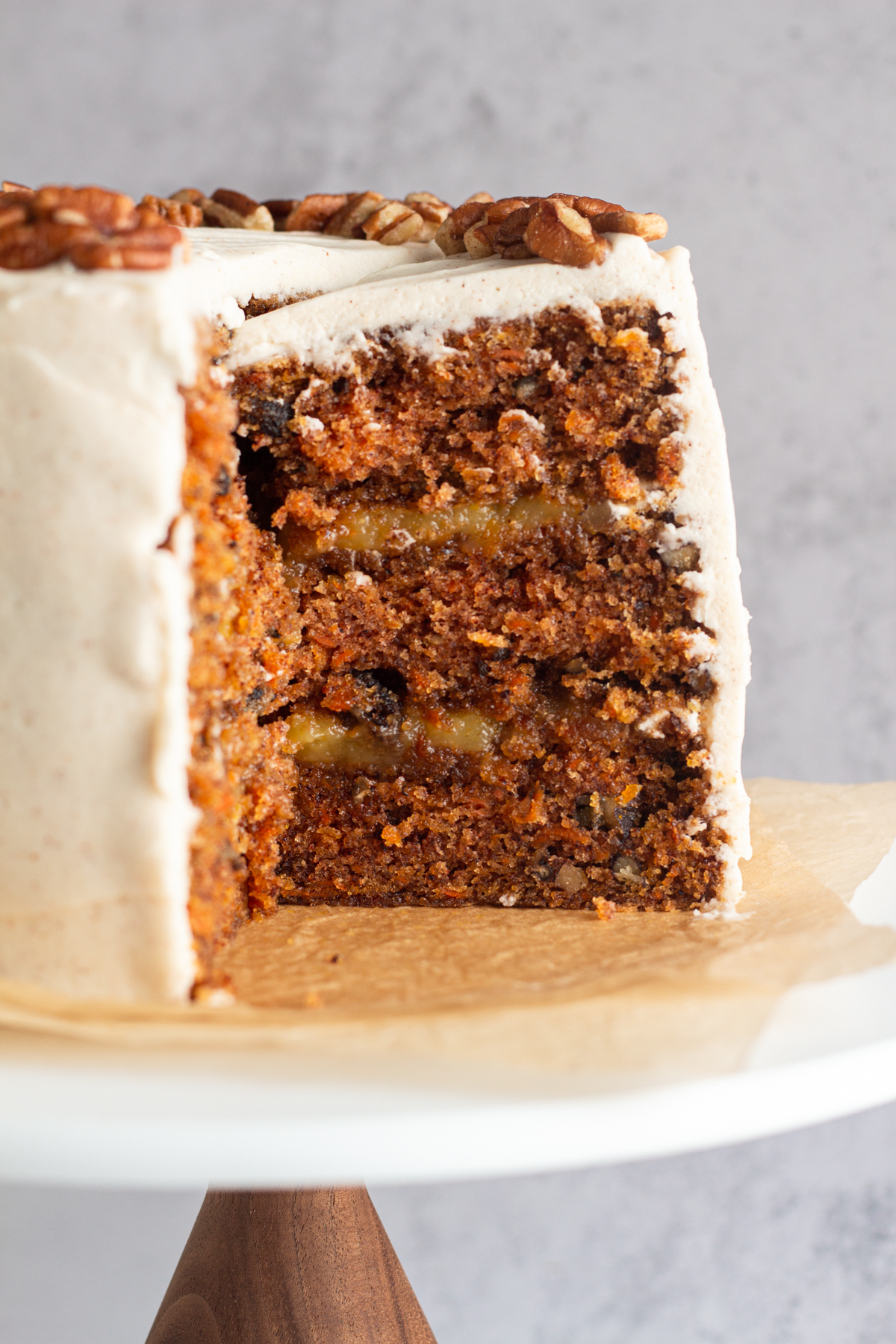 side view of a sliced carrot layer cake