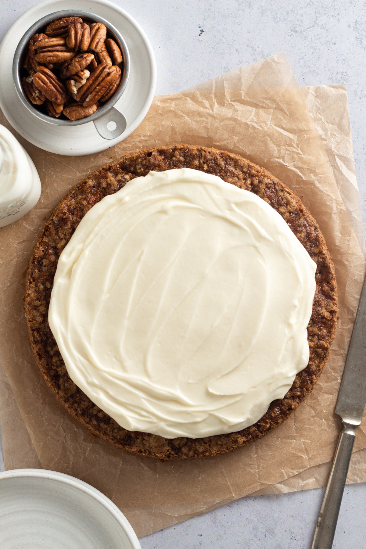overhead view of a round carrot cake with cream cheese frosting