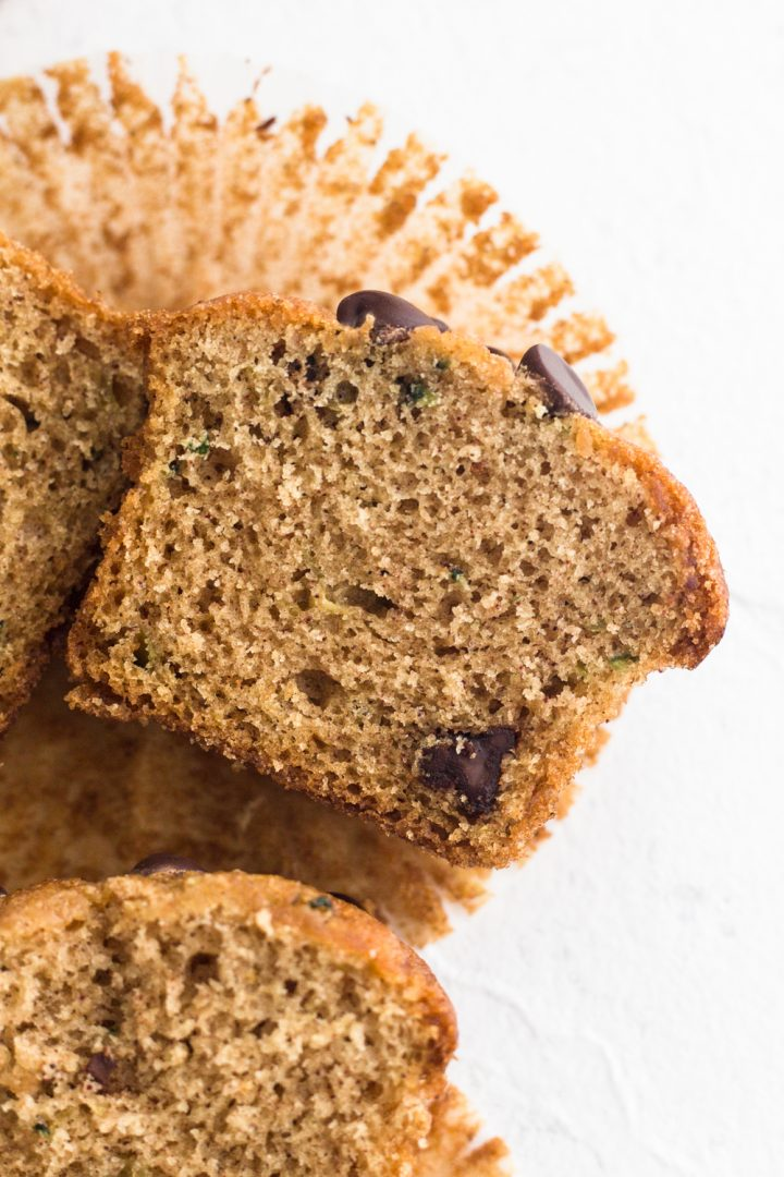 close up view of a sliced chocolate chip zucchini bread muffin