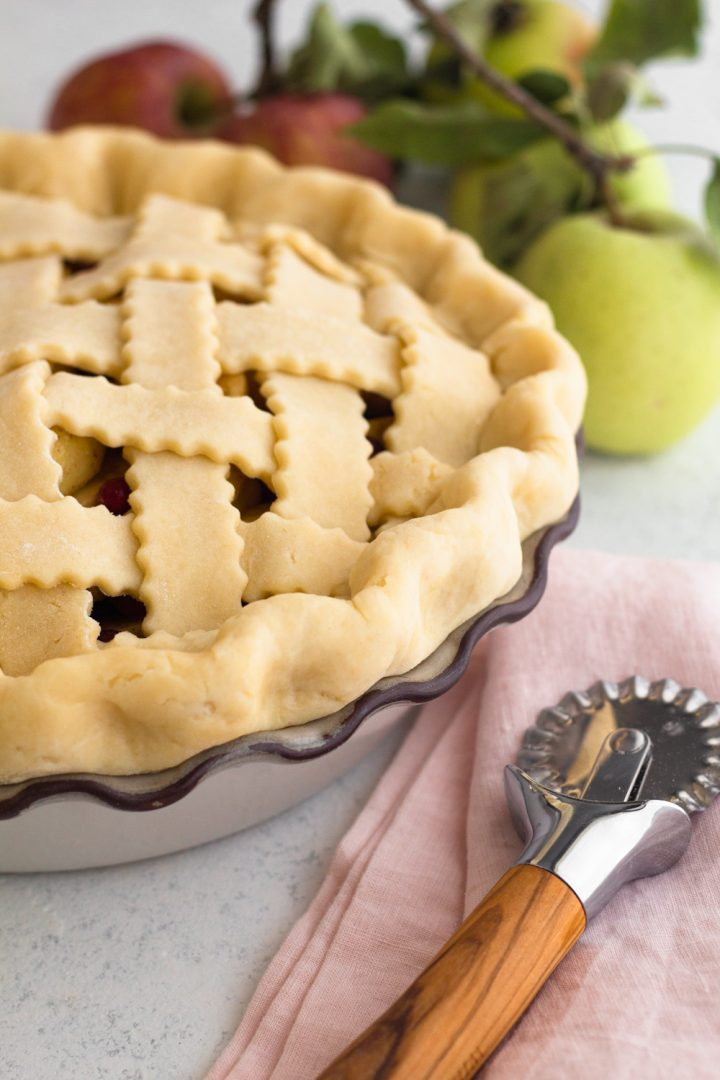 angled view of an unbaked lattice pie