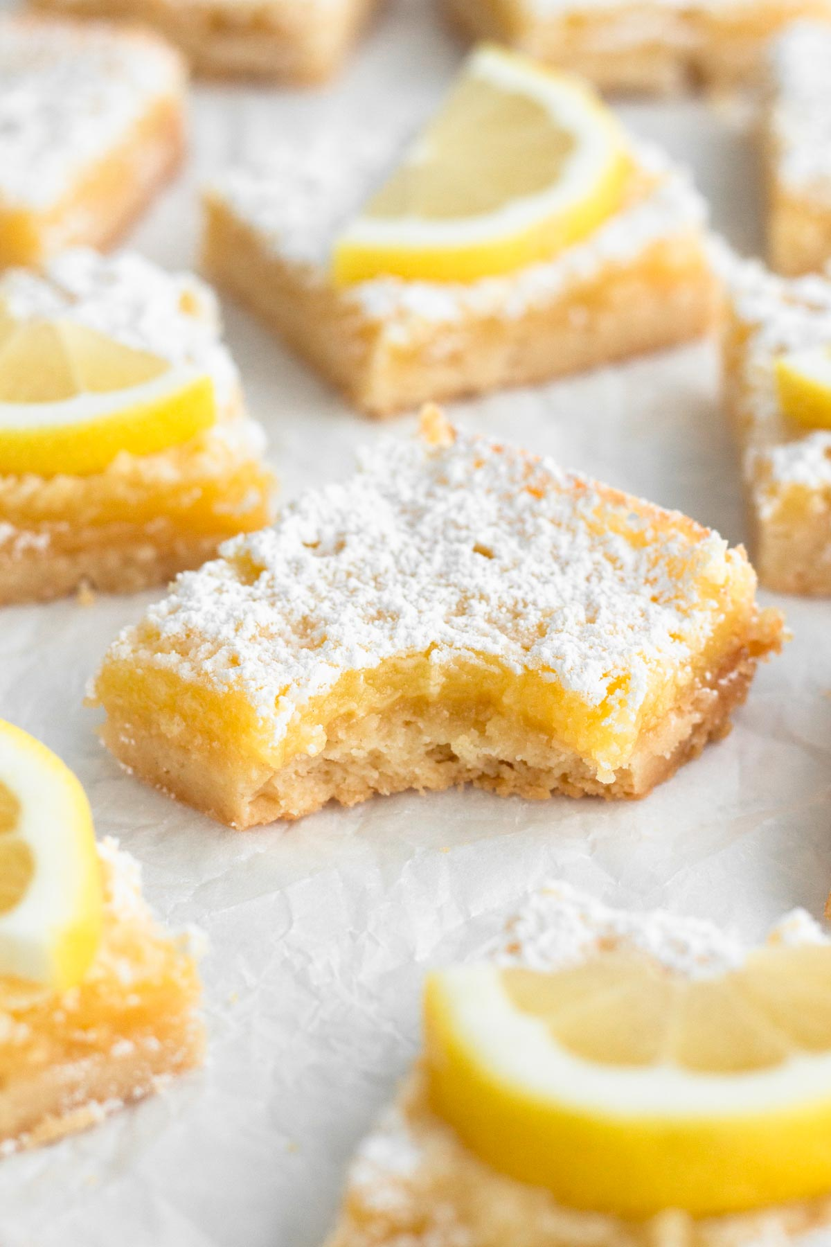 angled view of lemon bar with a bite missing