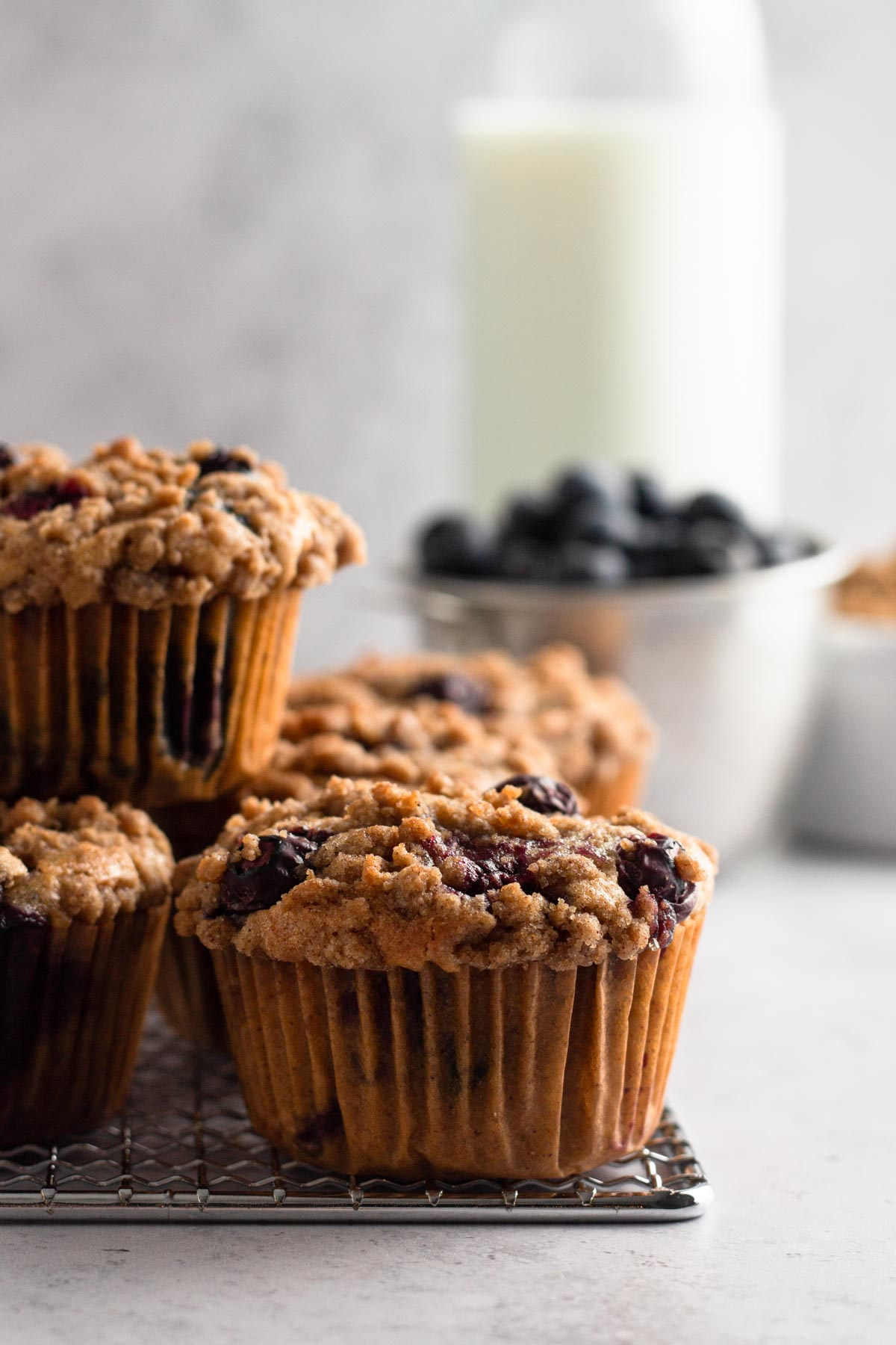 side view of muffins stacked on a cooling rack