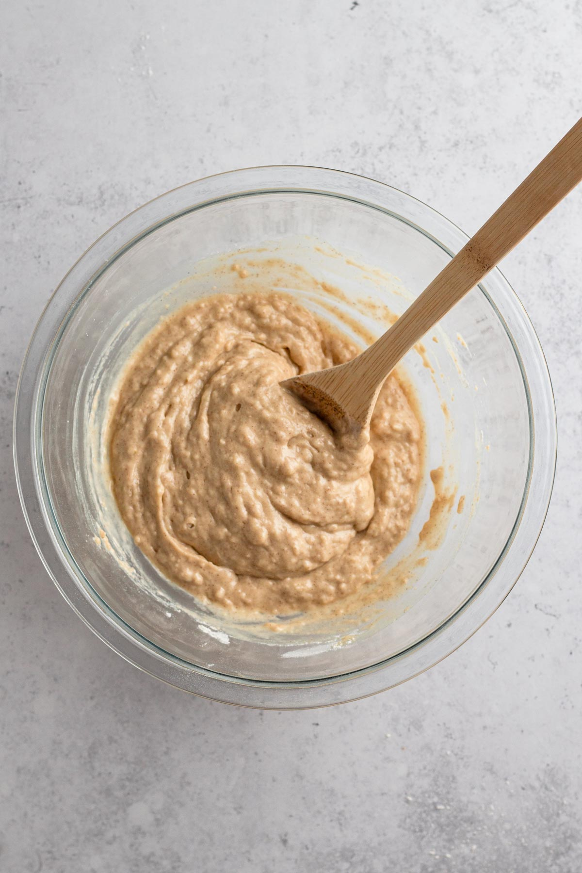 overhead view of muffin batter in a glass bowl