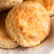 angled view of biscuits on a white linen napkin