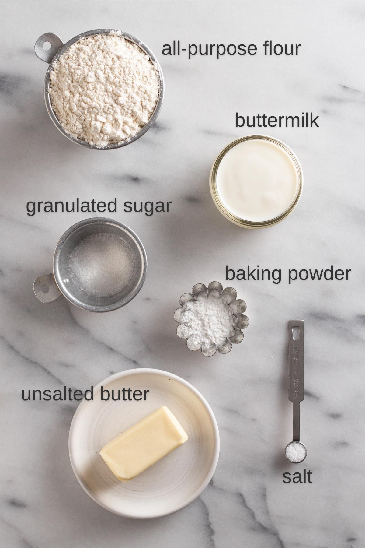 overhead view of recipe ingredients on a marble surface