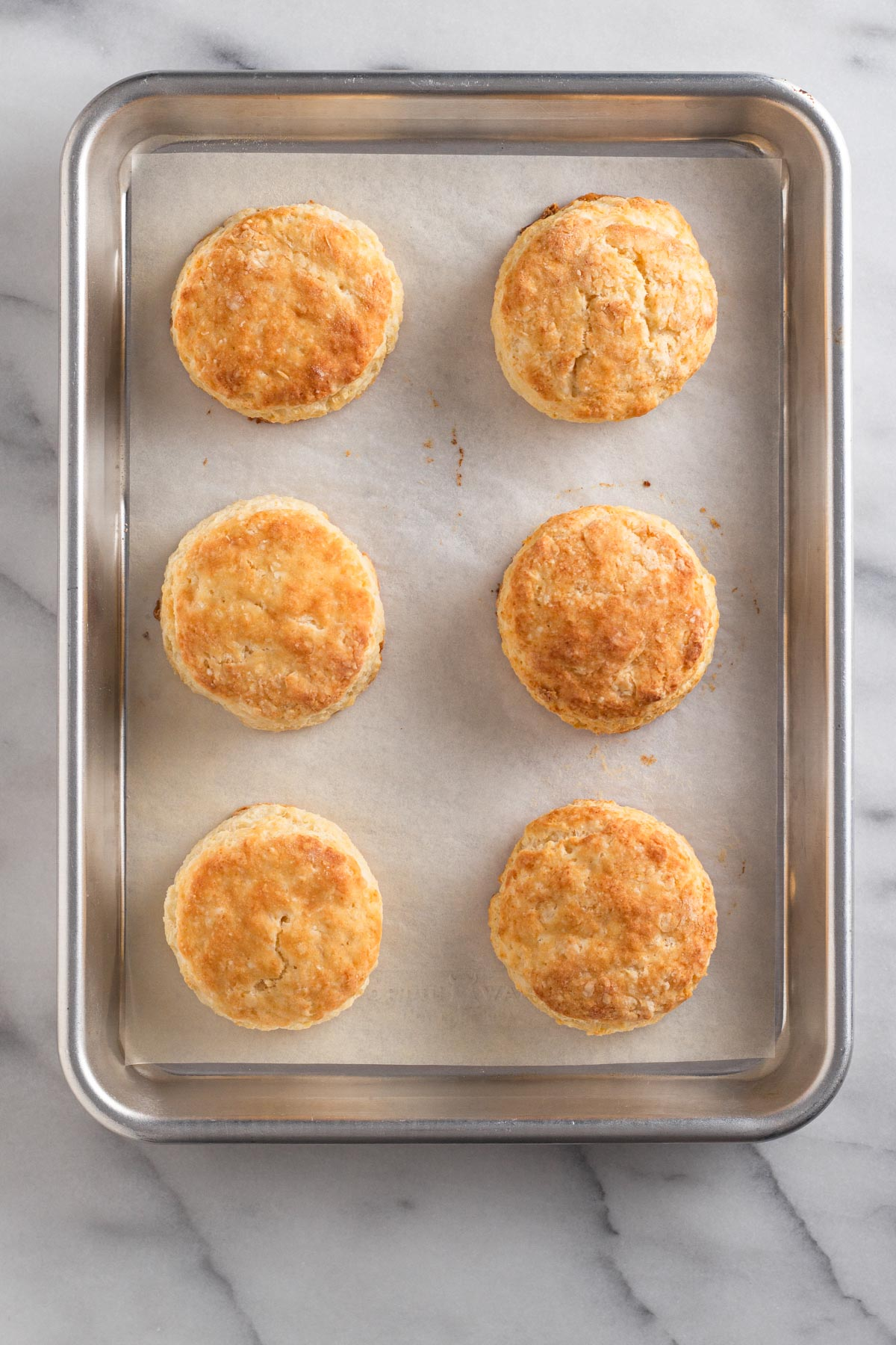 overhead view od biscuits on a baking sheet