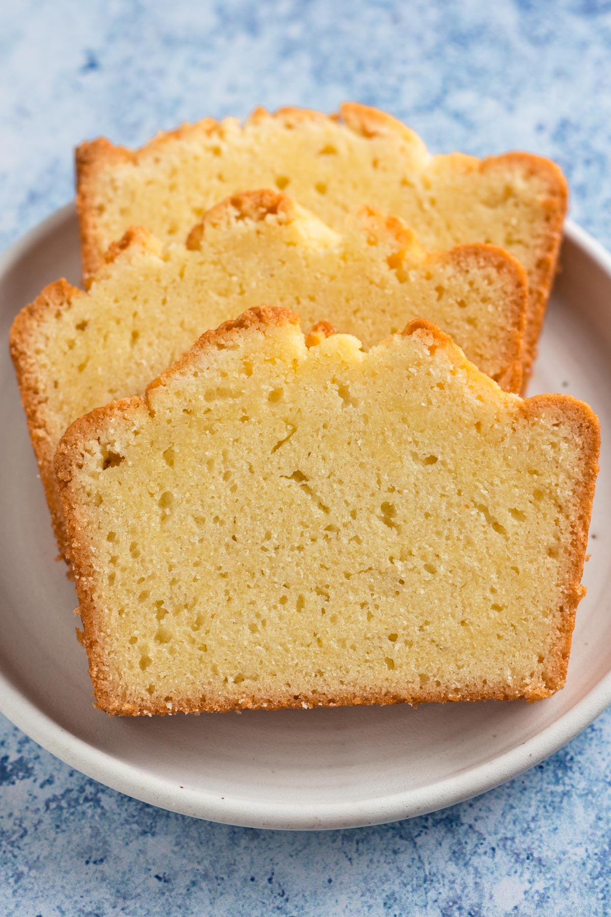 angled view of slices of pound cake on a white plate