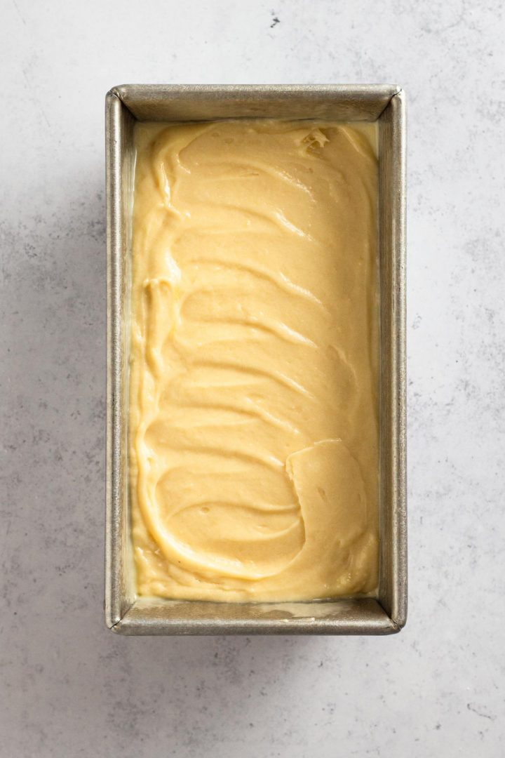 overhead view of cake batter in a loaf pan