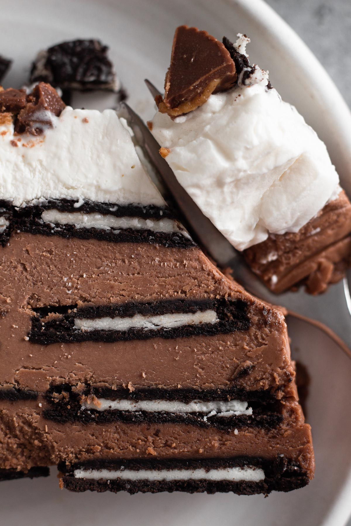 close-up overhead view of a slice of icebox cake with a forkful of cake