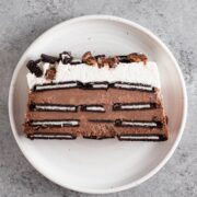 overhead view of a slice of icebox cake on a white plate