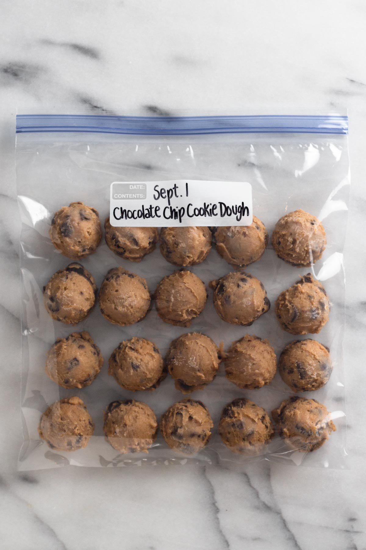 overhead view of cookie dough balls in a plastic bag