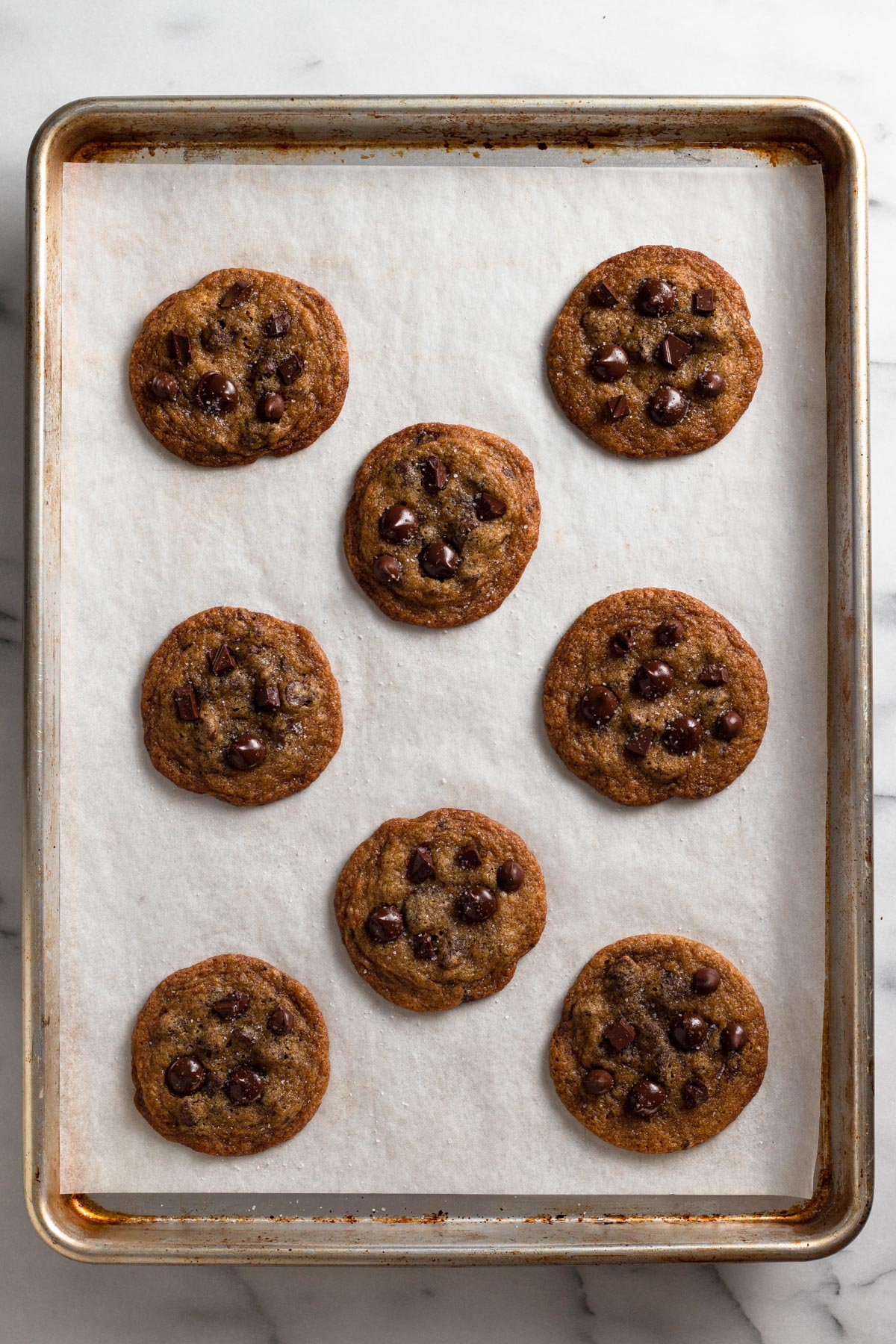 overhead view of pretty chocolate chip cookies on a baking sheet