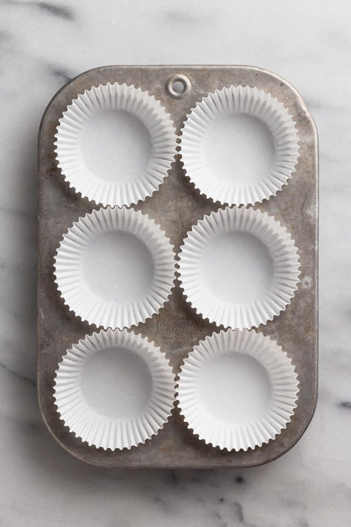 overhead view of muffin pan with paper liners
