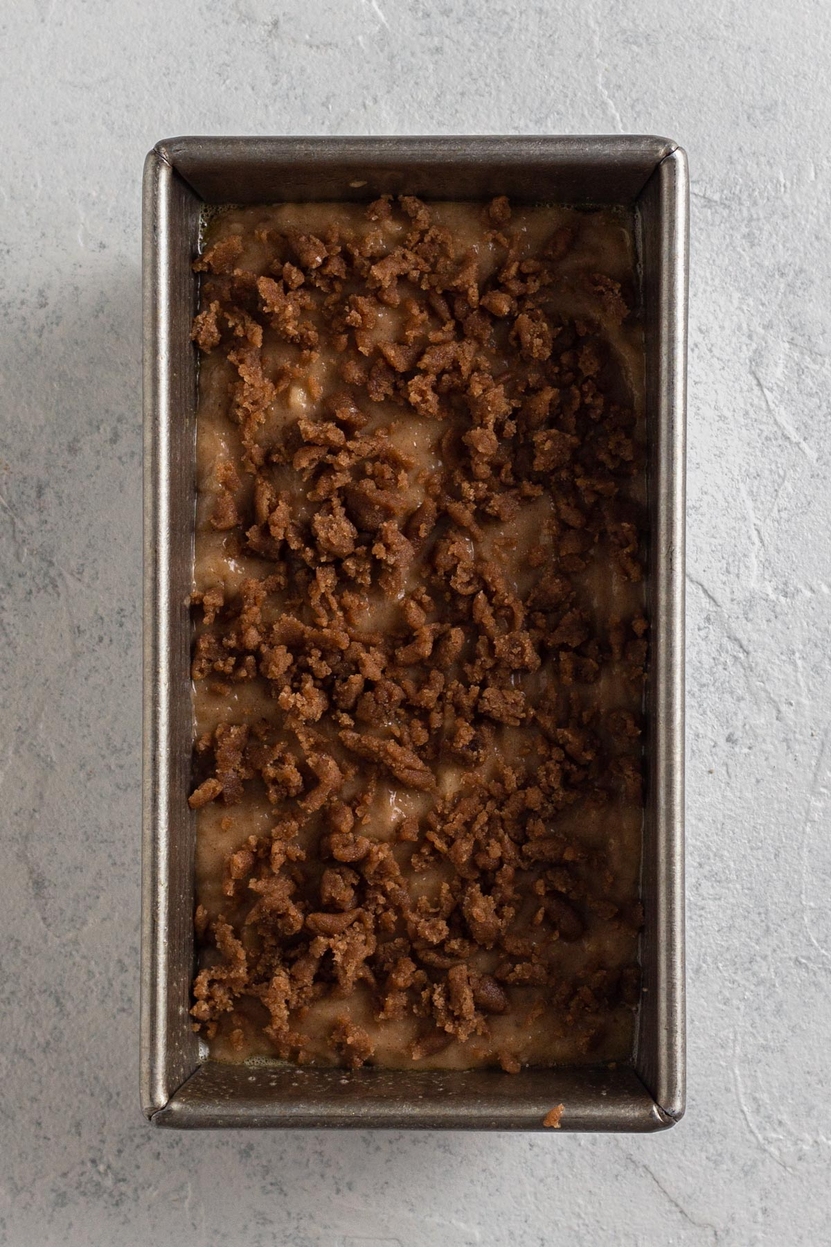 batter with streusel in loaf pan