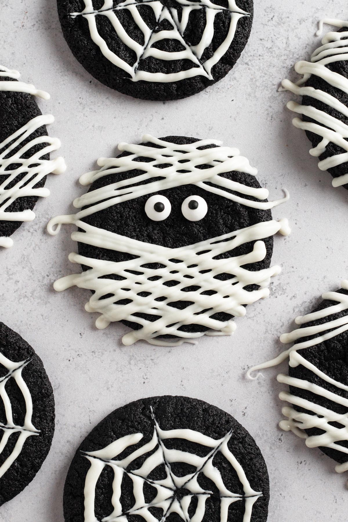 overhead view of mummy cookie on a gray surface