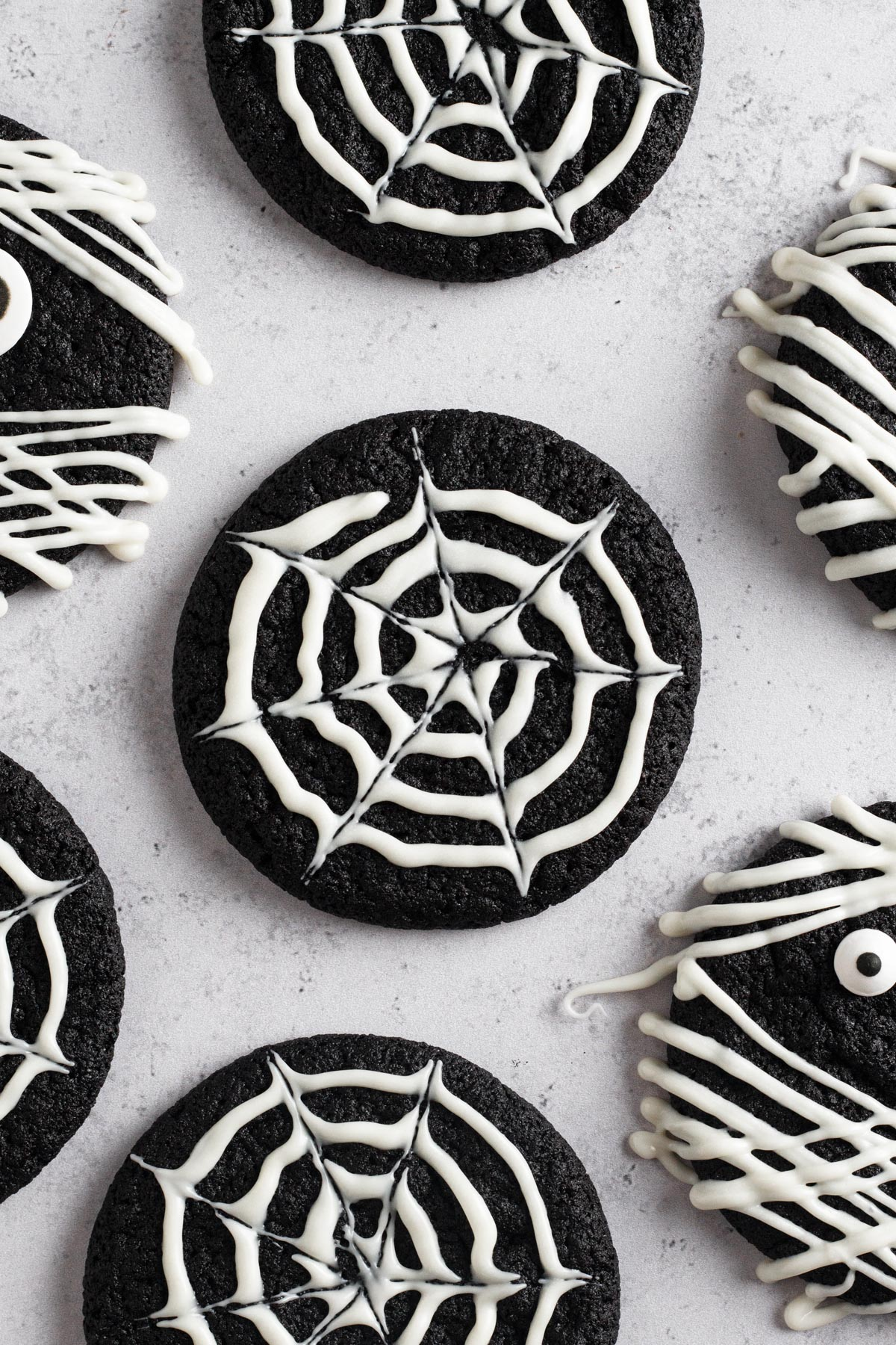 overhead view of spiderweb cookie on a gray surface